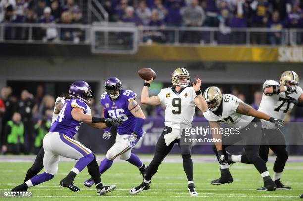 Drew Brees of the New Orleans Saints passes the ball under pressure from Brian Robison of the Minnesota Vikings during the first half of the NFC...