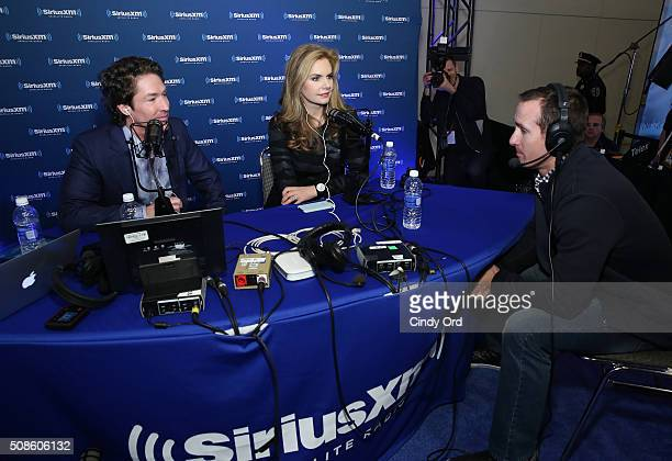 Drew Brees of the New Orleans Saints pastor Joel Osteen and Osteen's wife and copastor Victoria Osteen visit the SiriusXM set at Super Bowl 50 Radio...
