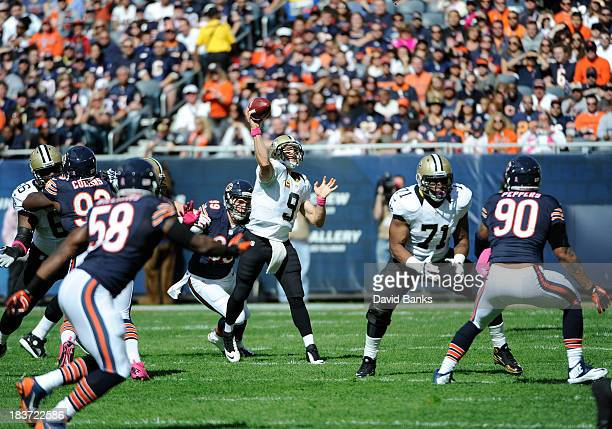Drew Brees of the New Orleans Saints plays against the Chicago Bears on October 6 2013 at Soldier Field in Chicago Illinois
