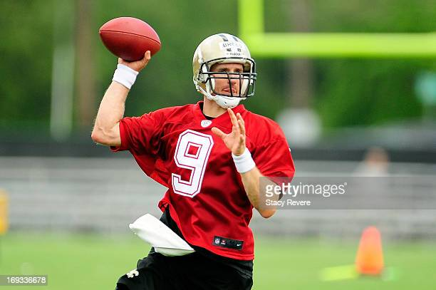 Drew Brees of the New Orleans Saints prepares to throw a pass during OTA's organized team activities at the Saints training facility on May 23 2013...