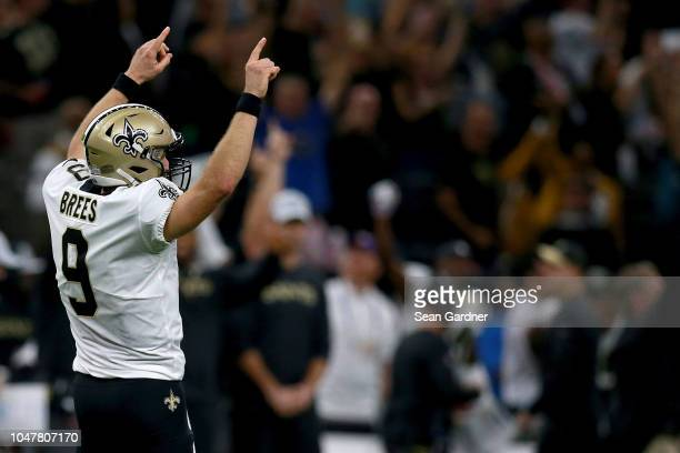 Drew Brees of the New Orleans Saints reacts after breaking Peyton Manning's record for AllTime Passing Yards during a game against the Washington...