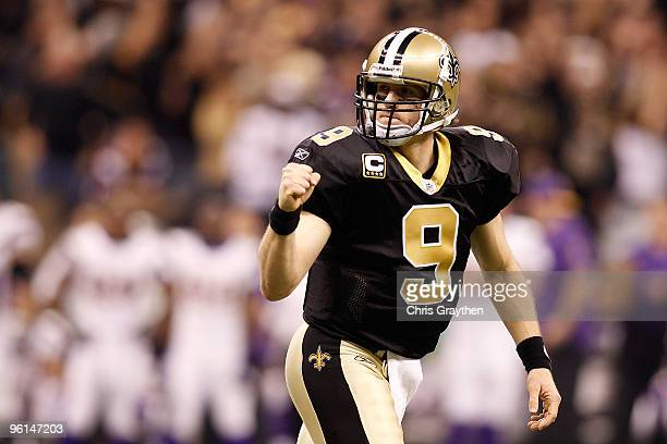 Drew Brees of the New Orleans Saints reacts after he threw a 9yard touchdown pass in the second quarter against the Minnesota Vikings during the NFC...