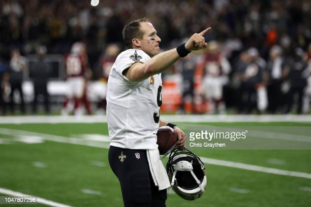 Drew Brees of the New Orleans Saints reacts after throwing a 62 yard pass to take the all time yardage record against the Washington Redskins at...