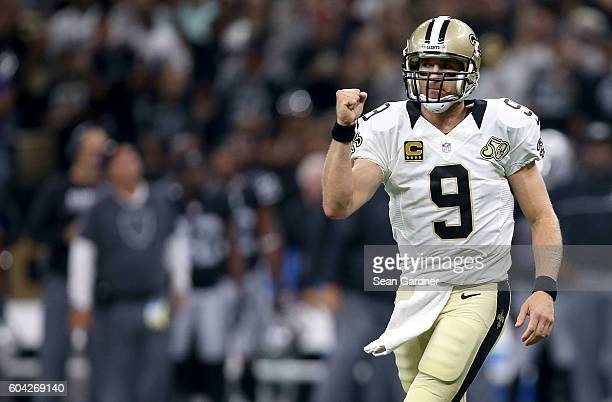 Drew Brees of the New Orleans Saints reacts after throwing a touchdown pass during second quarter against the Oakland Raiders at the MercedesBenz...