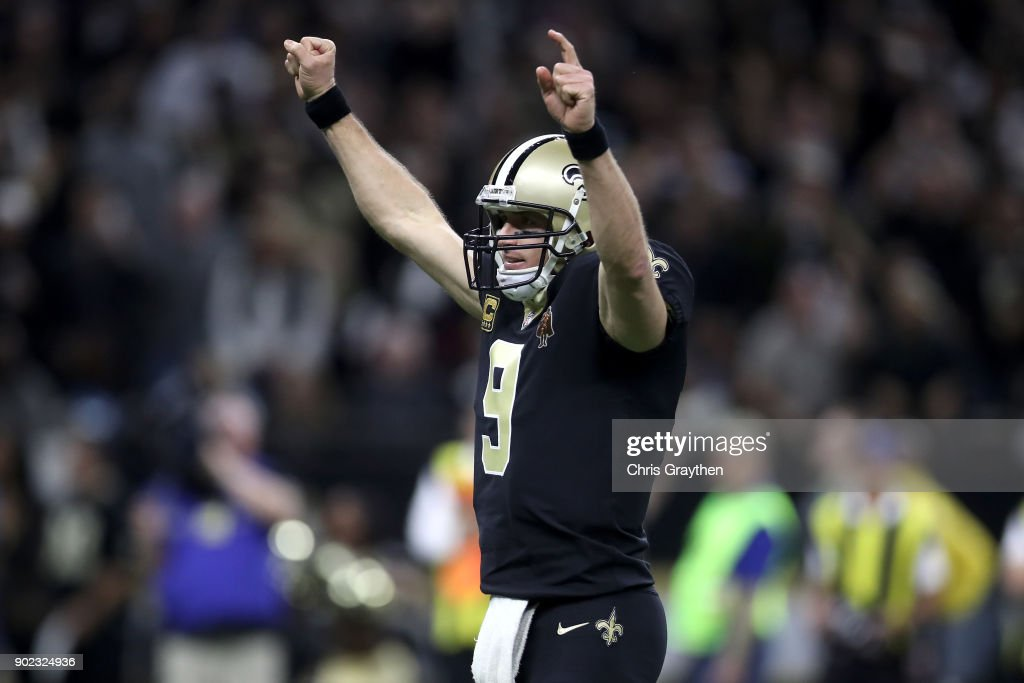 Drew Brees #9 of the New Orleans Saints reacts after throwing a touchdown pass against the Carolina Panthers at the Mercedes-Benz Superdome on January 7, 2018 in New Orleans, Louisiana.