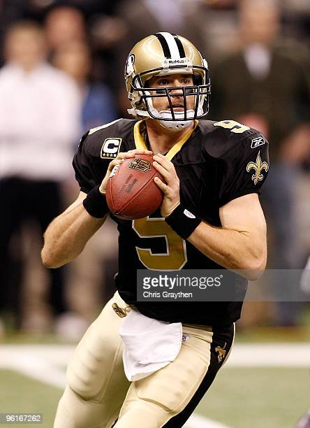 Drew Brees of the New Orleans Saints rolls out to pass against the Minnesota Vikings during the NFC Championship Game at the Louisana Superdome on...