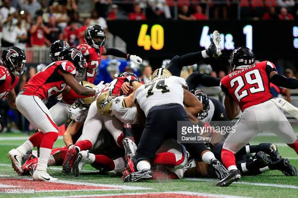 Drew Brees of the New Orleans Saints scores a touchdown in overtime to beat the Atlanta Falcons at Mercedes-Benz Stadium on September 23, 2018 in...
