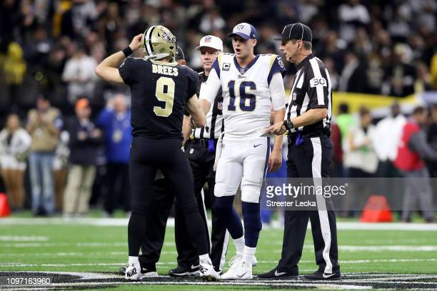 Drew Brees of the New Orleans Saints shakes hands with Jared Goff of the Los Angeles Rams at the start of overtime in the NFC Championship game at...