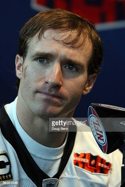 Drew Brees of the New Orleans Saints speaks to members of the media during Super Bowl XLIV Media Day at Sun Life Stadium on February 2 2010 in Miami...