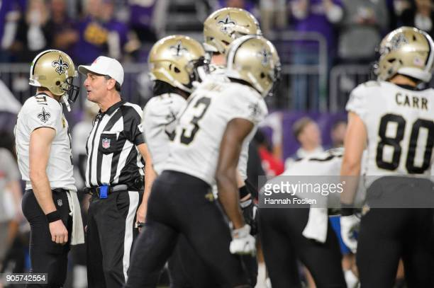 Drew Brees of the New Orleans Saints speaks with referee Gene Steratore during the first half of the NFC Divisional Playoff game against the...