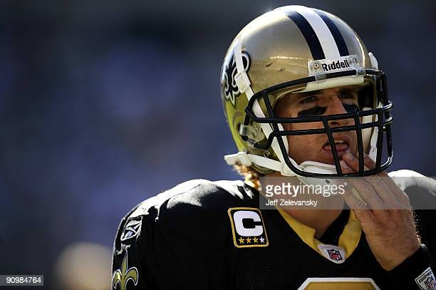Drew Brees of the New Orleans Saints stands during a timeout during a game against the Philadelphia Eagles at Lincoln Financial Field on September 20...