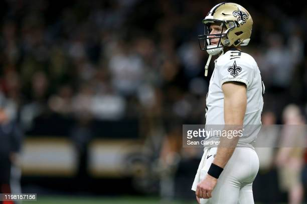 Drew Brees of the New Orleans Saints stands on the field during the NFC Wild Card Playoff game against the Minnesota Vikings at Mercedes Benz...