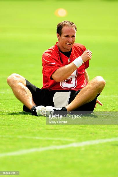 Drew Brees of the New Orleans Saints stretches during OTA's organized team activities at the Saints training facility on May 23 2013 in Metairie...