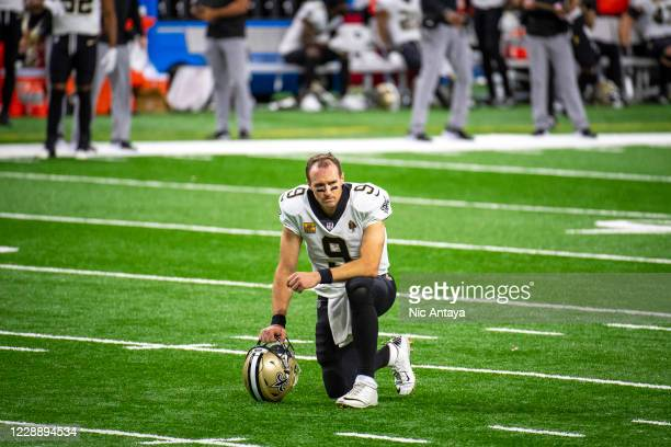 Drew Brees of the New Orleans Saints takes a knee during the second quarter against the New Orleans Saints at Ford Field on October 4, 2020 in...