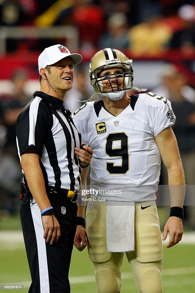 Drew Brees #9 of the New Orleans Saints talks to an official during the second half against the Atlanta Falcons at the Georgia Dome on January 3, 2016 in Atlanta, Georgia.