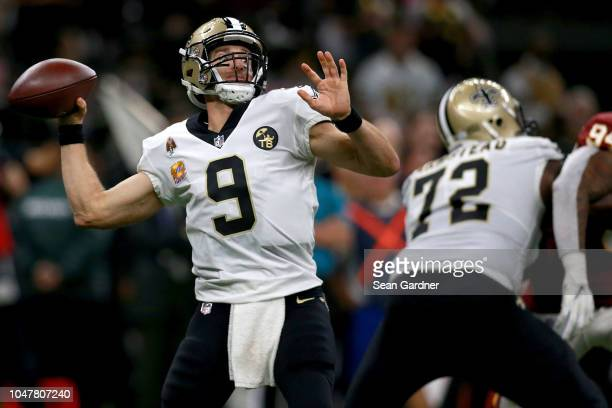 Drew Brees of the New Orleans Saints throws a 62 yard pass to break Peyton Manning's record for AllTime Passing Yards during a game against the...