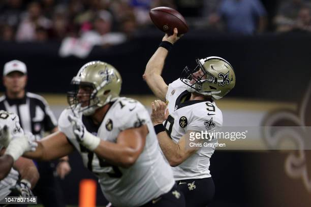 Drew Brees of the New Orleans Saints throws a 62 yard pass to take the all time NFL yardage record against the Washington Redskins at MercedesBenz...