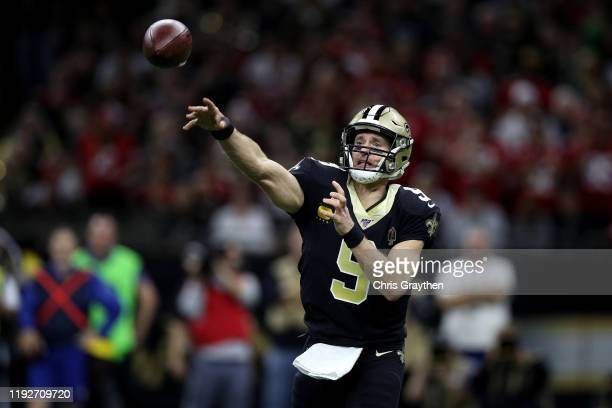Drew Brees of the New Orleans Saints throws a pass against the San Francisco 49ers during the first quarter in the game at Mercedes Benz Superdome on...