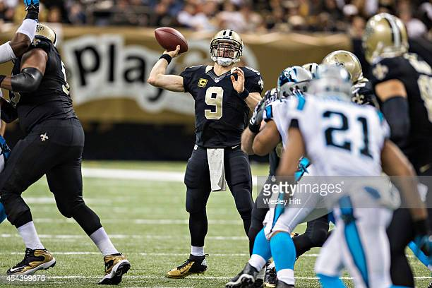Drew Brees of the New Orleans Saints throws a pass during a game against the Carolina Panthers at MercedesBenz Superdome on December 8 2013 in New...