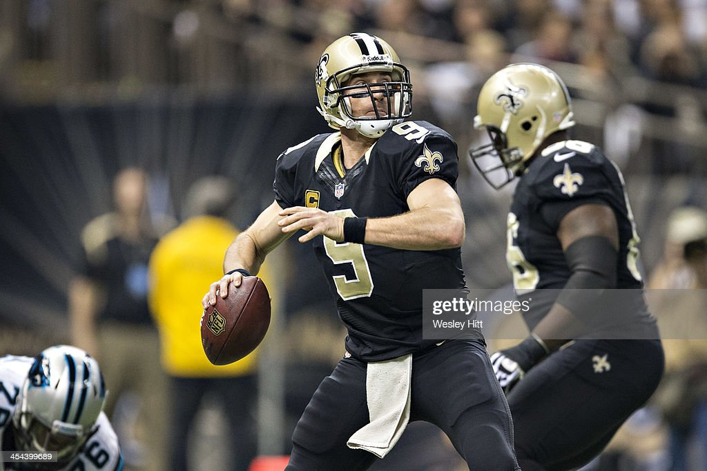 Drew Brees #9 of the New Orleans Saints throws a pass during a game against the Carolina Panthers at Mercedes-Benz Superdome on December 8, 2013 in New Orleans, Louisiana. The Saints defeated the Panthers 31-13.