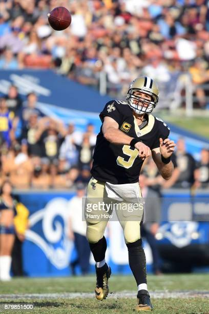 Drew Brees of the New Orleans Saints throws a pass during the third quarter of the game against the Los Angeles Rams at the Los Angeles Memorial...