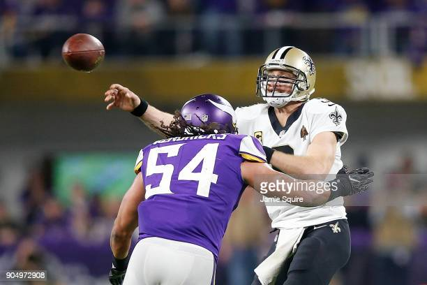 Drew Brees of the New Orleans Saints throws a pass under pressure from Eric Kendricks of the Minnesota Vikings during the second half of the NFC...