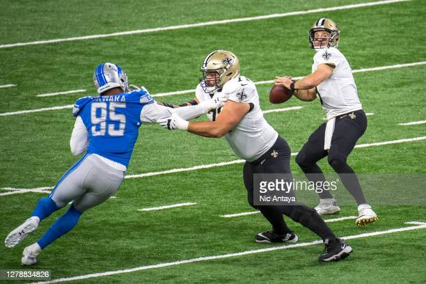 Drew Brees of the New Orleans Saints throws the ball while Ryan Ramczyk of the New Orleans Saints blocks Romeo Okwara of the Detroit Lions during the...