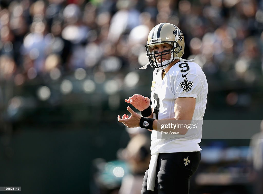 Drew Brees #9 of the New Orleans Saints waits for the play to resume during their game against the Oakland Raiders at O.co Coliseum on November 18, 2012 in Oakland, California.