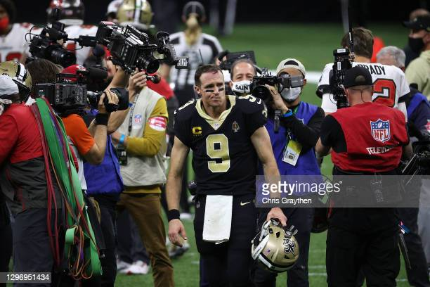 Drew Brees of the New Orleans Saints walks off the field after being defeated by the Tampa Bay Buccaneers in the NFC Divisional Playoff game at...