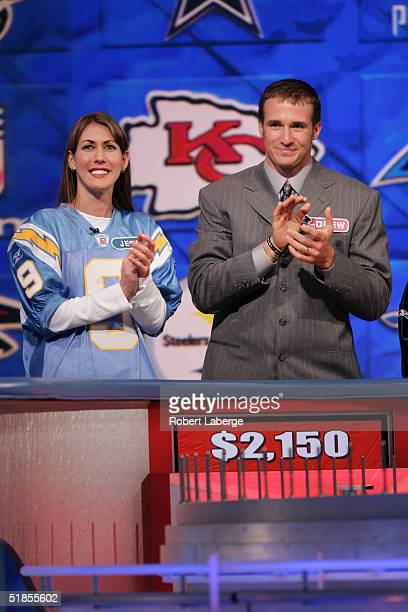 Drew Brees of the San Diego Chargers applauds with his favorite Charger fan during the Wheel of Fortune NFL Players Week taping on December 7 2004 at...