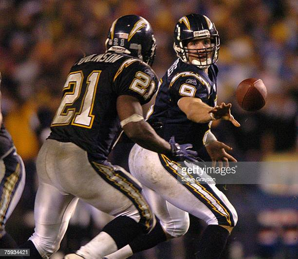 Drew Brees of the San Diego Chargers hands off to LaDainian Tomlinson in the second half of the firsthalf of the AFC Wild Card Playoffs at Qualcomm...