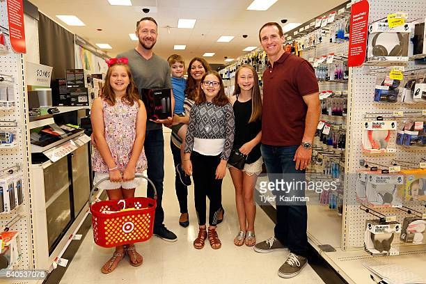 Drew Brees Quarterback of the New Orleans Saints surprises Target guests and helps them shop for last minute father's day gifts at Target on June 15...