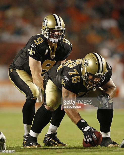 Drew Brees takes a snap from Jonathan Goodwin of the New Orleans Saints against the Miami Dolphins on October 25 2009 at LandShark Stadium in Miami...