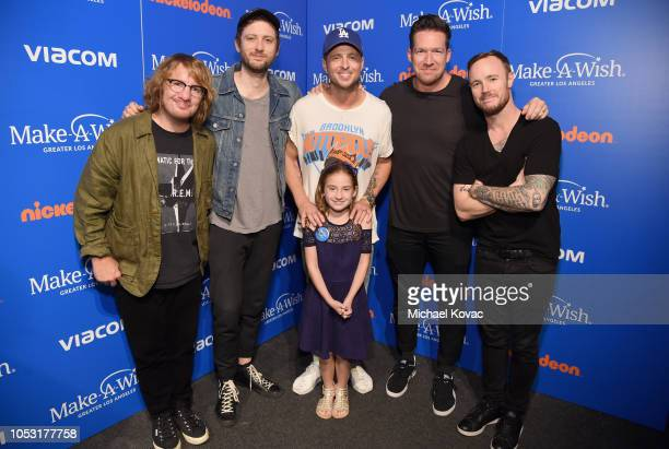 Drew Brown Brent Kutzle Ryan Tedder Zach Filkins and Eddie Fisher from the band OneRepublic poses backstage with a Wish Kid at the 2018 Make A Wish...