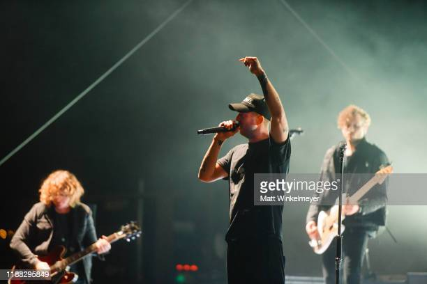 """Drew Brown, Ryan Tedder, and Brent Kutzle of OneRepublic performs at Enterprise's """"Share the Code. Hit the Road"""" at famed venue Pappy & Harriet's in..."""