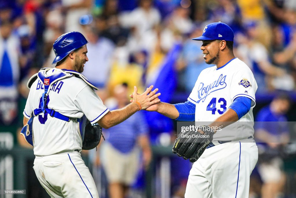 Drew Butera #9 and Wily Peralta #43 of the Kansas City Royals celebrates the win over the Chicago Cubs at Kauffman Stadium on August 8, 2018 in Kansas City, Missouri.