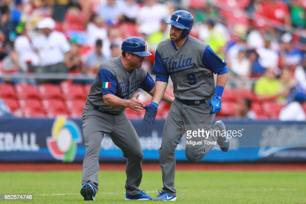 Drew Butera of Italy reacts after hits a hime run in the top of the second inning during the World Baseball Classic Pool D Game 5 between Italy and...