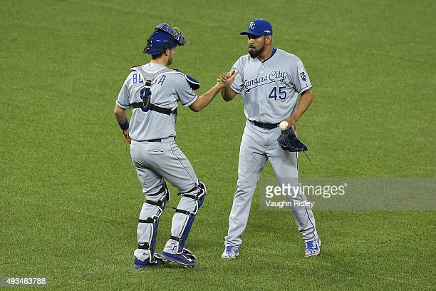 Drew Butera of the Kansas City Royals and Franklin Morales of the Kansas City Royals celebrate defeating the Toronto Blue Jays 142 in game four of...