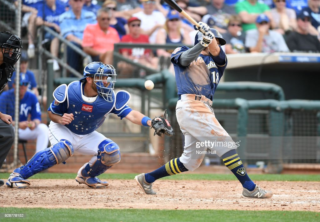 Drew Butera #9 of the Kansas City Royals cannot come up with a foul ball hit by Eric Sogard #18 of the Milwaukee Brewers during the fifth inning of a spring training game at Surprise Stadium on March 7, 2018 in Surprise, Arizona.