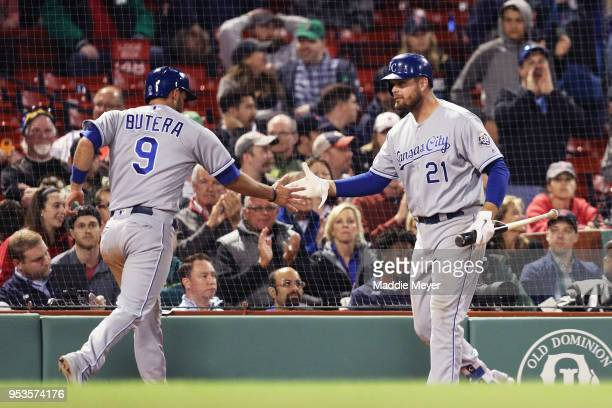 Drew Butera of the Kansas City Royals celebrates with Lucas Duda after scoring a run against the Boston Red Sox during the twelfth inning at Fenway...
