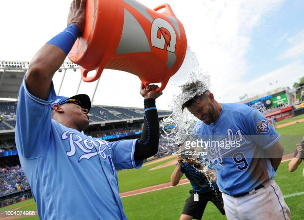 Drew Butera of the Kansas City Royals is doused with water by Salvador Perez as they celebrate a 53 win over the Minnesota Twins at Kauffman Stadium...
