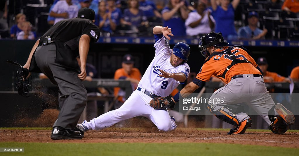 Drew Butera #9 of the Kansas City Royals is tagged out at home by Jason Castro #15 of the Houston Astros as plate umpire Mark Ripperger waits to make the call in the ninth inning at Kauffman Stadium on June 25, 2016 in Kansas City, Missouri. Butera was tagged out on the play.