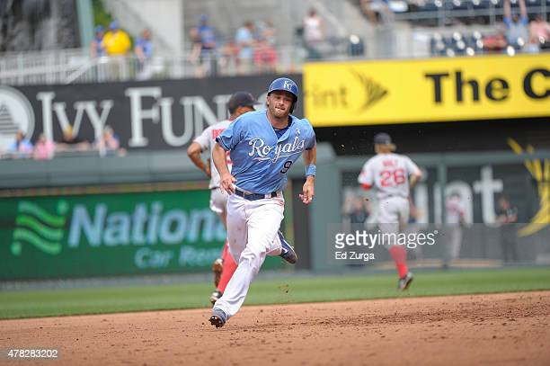 Drew Butera of the Kansas City Royals runs to third as he advances against the Boston Red Sox at Kauffman Stadium on June 21 2015 in Kansas City...
