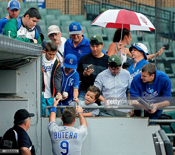 Drew Butera of the Kansas City Royals signs autographs for fans before the game against the Chicago White Sox at US Cellular Field on September 9...