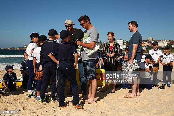 Drew Butera of the Los Angeles Dodgers meets players from Illawong Little League during a Los Angeles Dodgers players visit at Bondi Beach on March...