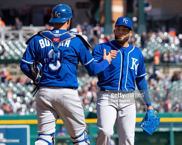 Drew Butera slaps hands with pitcher Kelvin Herrera of the Kansas City Royals after a MLB game against the Detroit Tigers at Comerica Park on April...