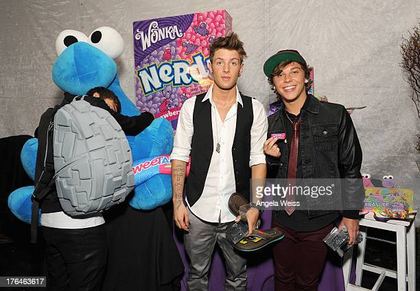 Drew Chadwick and Keaton Stromberg of Emblem3 attend the Backstage Creations Celebrity Retreat At Teen Choice 2013 Day 2 at Gibson Amphitheatre on...