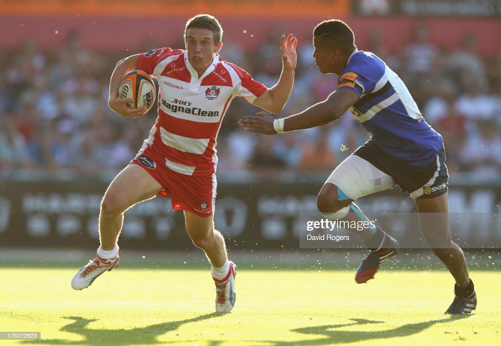 Drew Cheshire of Gloucester holds off Anthony Watson of Bath during the J.P. Morgan Asset Management Premiership Rugby 7's held at Kingsholm Stadium on August 1, 2013 in Gloucester, England.