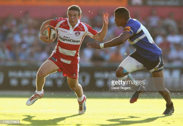 Drew Cheshire of Gloucester holds off Anthony Watson of Bath during the JP Morgan Asset Management Premiership Rugby 7's held at Kingsholm Stadium on...