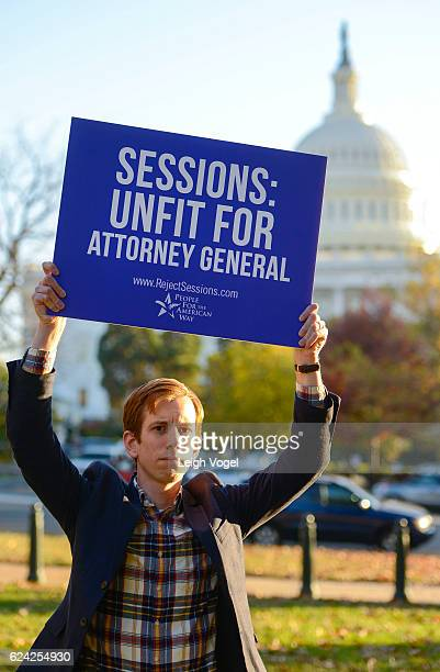 Drew Courtney Director of Communications for People for the American Way holds a sign to call on senate to reject Jeff Sessions as Attorney General...